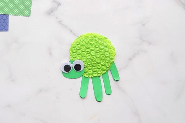 Glue on Googly Eyes to Turtle Head