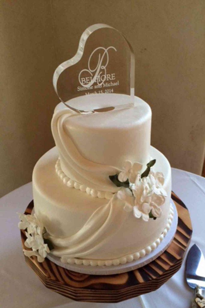 Elegant Wedding Cake With White Drapes The French Gourmet