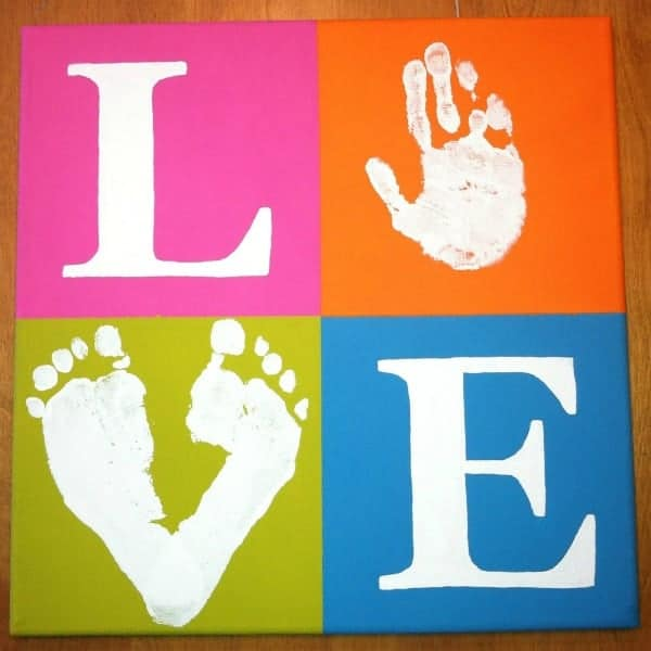 Love canvas sign made with hand prints and footprints, great DIY mother's day gift.