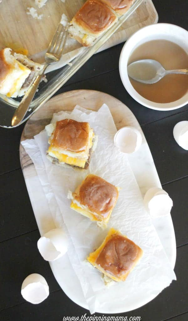 Easy breakfast or brunch for a crowd. Sausage egg and cheese breakfast sliders with syrup glaze. A sweet and salty treat!