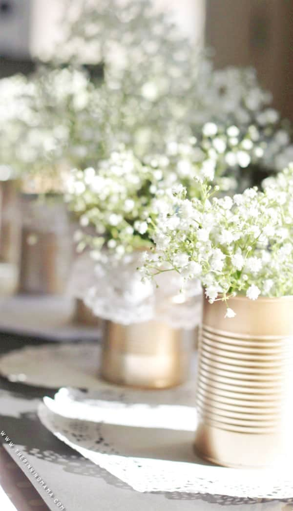 Perfect DIY idea for a vintage or shabby chic wedding!  These gold and lace tin cans are stunning and EASY to make!