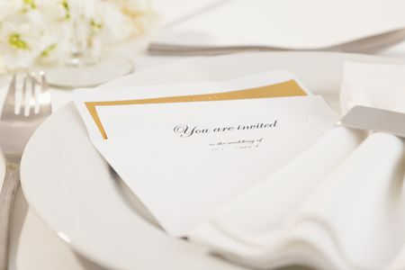 550  Free Wedding Invitation Templates You Can Customize Close up of wedding invitation on plate