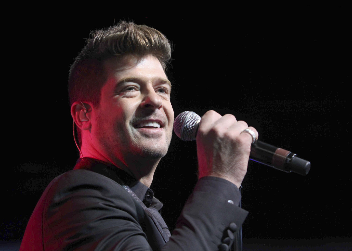 Judge restricts singer Robin Thicke's contact with son in ...