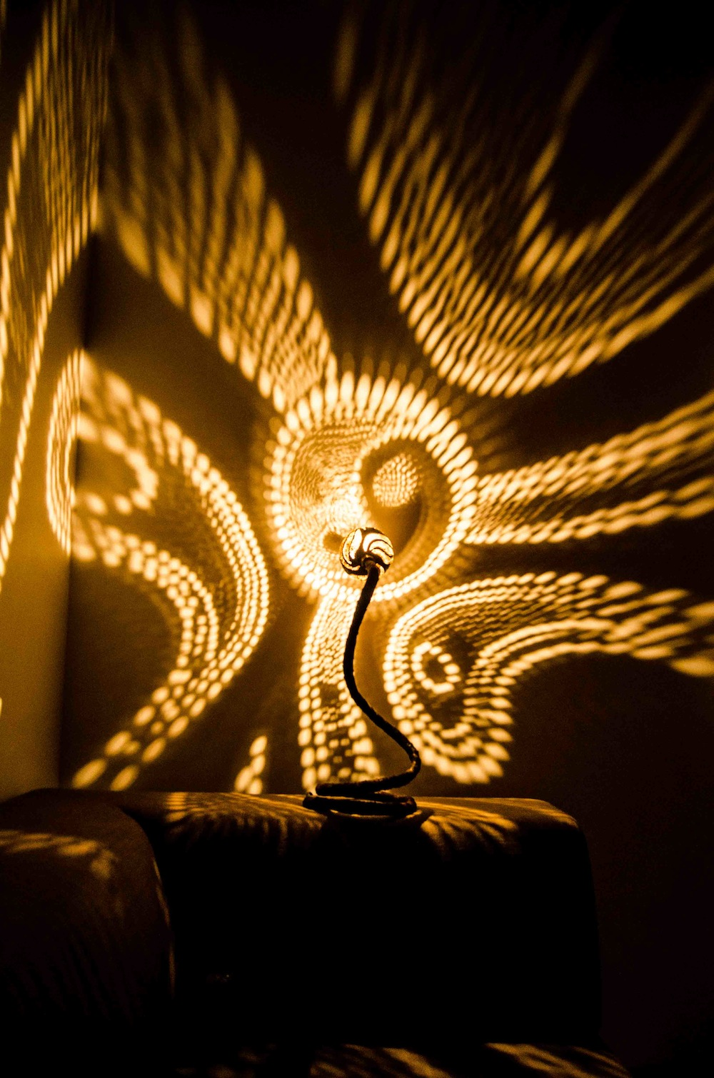 Serpentine Lamps Drilled From Coconut Shells Cast Dazzling