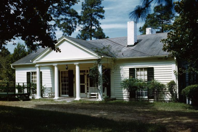 9 Building Plan Books for Cozy  Affordable Cottages small white house with black shutters  large central portico with four  columns and a pediment