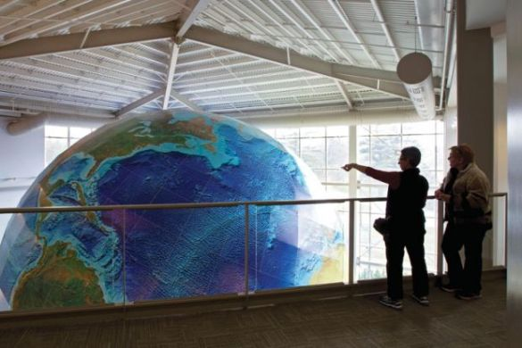 map globe store      Its All About Maps In The World   World Maps List New tool aims to boost universities flagging green efforts THE News People  viewing rotating globe DeLorme