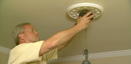 How to Install a Chandelier and Dimmer Switch   Today s Homeowner Danny Lipford installing a Chandelier
