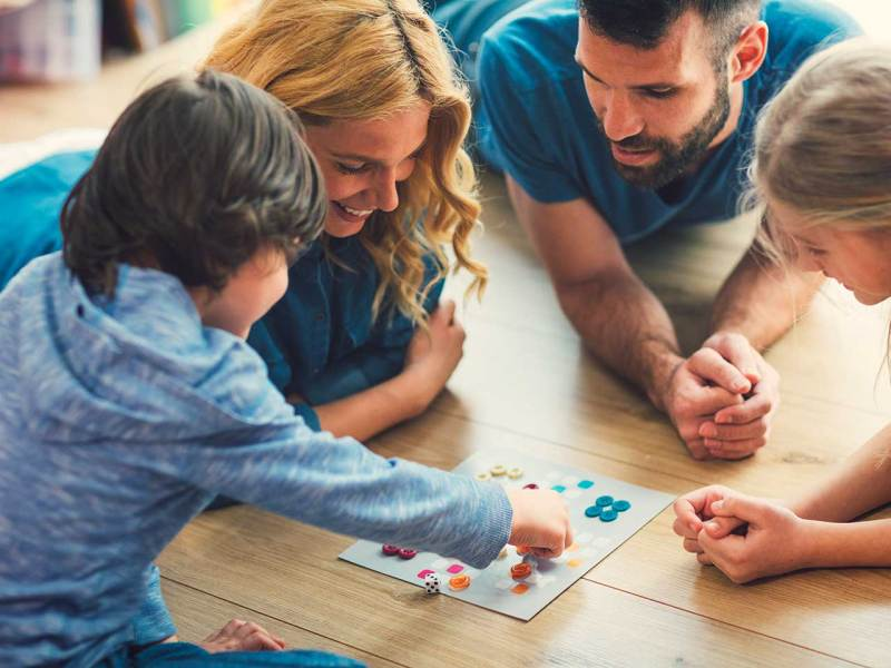 6 best cooperative board games for kids who hate to lose Family playing board game