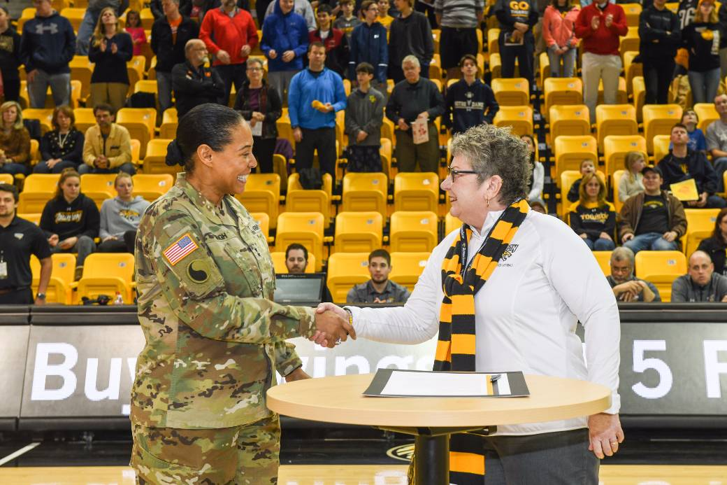 TU partnership with National Guard strengthened   Towson University Towson University President Kim Schatzel shakes hands with Maryland  Adjutant General Linda Singh after signing a