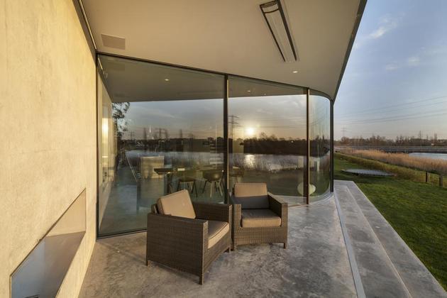 Diamond Shaped House With Curving Glass Windows Modern