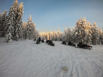 Snowmobiles in the mountains – winter attraction in Rovaniemi, Finland