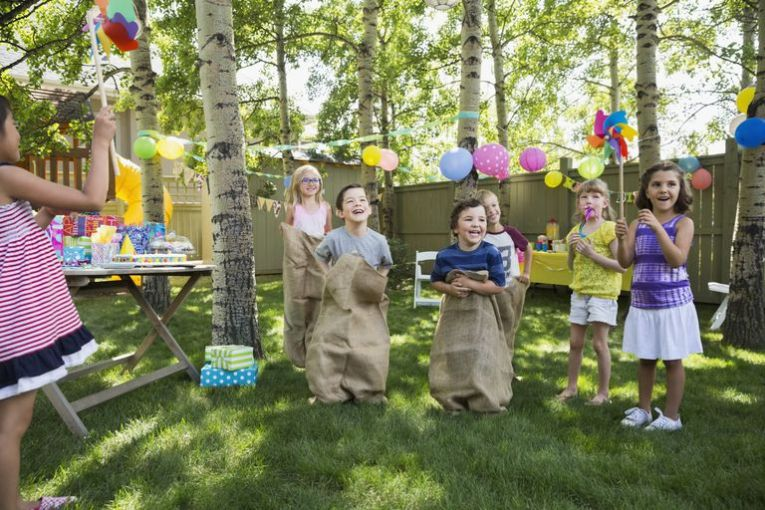 Plan Outdoor Obstacle Games for a Kids  Birthday Party Kids enjoying sack race at backyard birthday party
