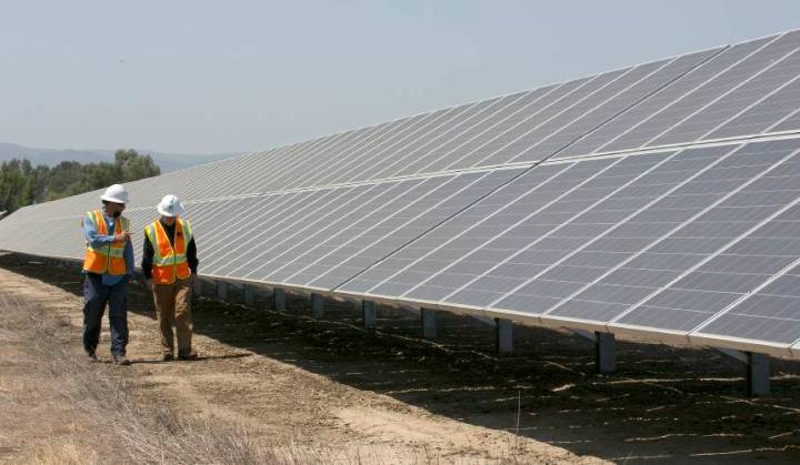 Valley News   Trade Ruling Stuns U S  Solar Industry 17  2017  file photo  solar tech Joshua Valdez  left  and senior plant  managerTim Wisdom walk past solar panels at a Pacific Gas and Electric Solar  Plant