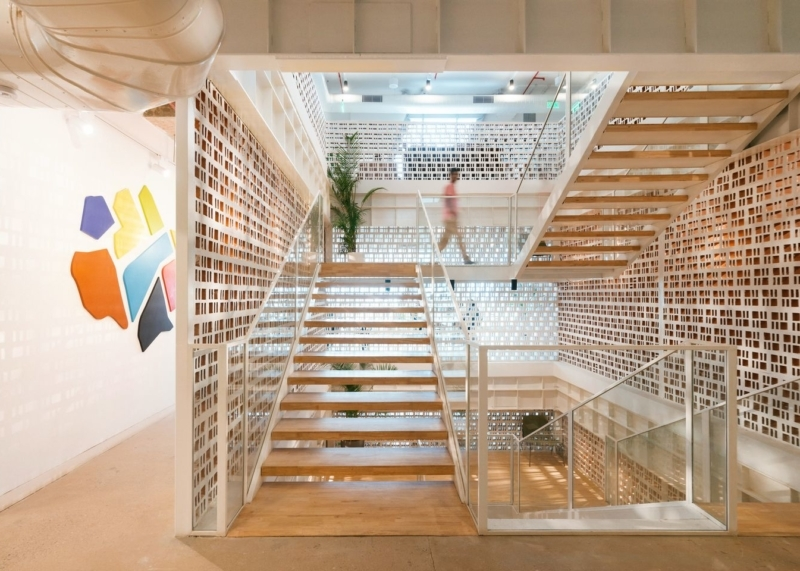 10 Stunning Staircases In Wework Locations Around The World Ideas | Ceiling Design For Stairs Area | Stairwell | Accent Lighting | Cake Shop | Cafeteria | L Shape