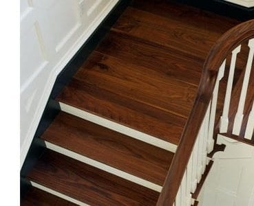 Design Ideas For Stairs To Match Your Custom Hardwood Floors | Hardwood Floor To Stair Transition | Porcelain Tile | Molding | Stair Tread | Vinyl Plank | Carpeted Stairs