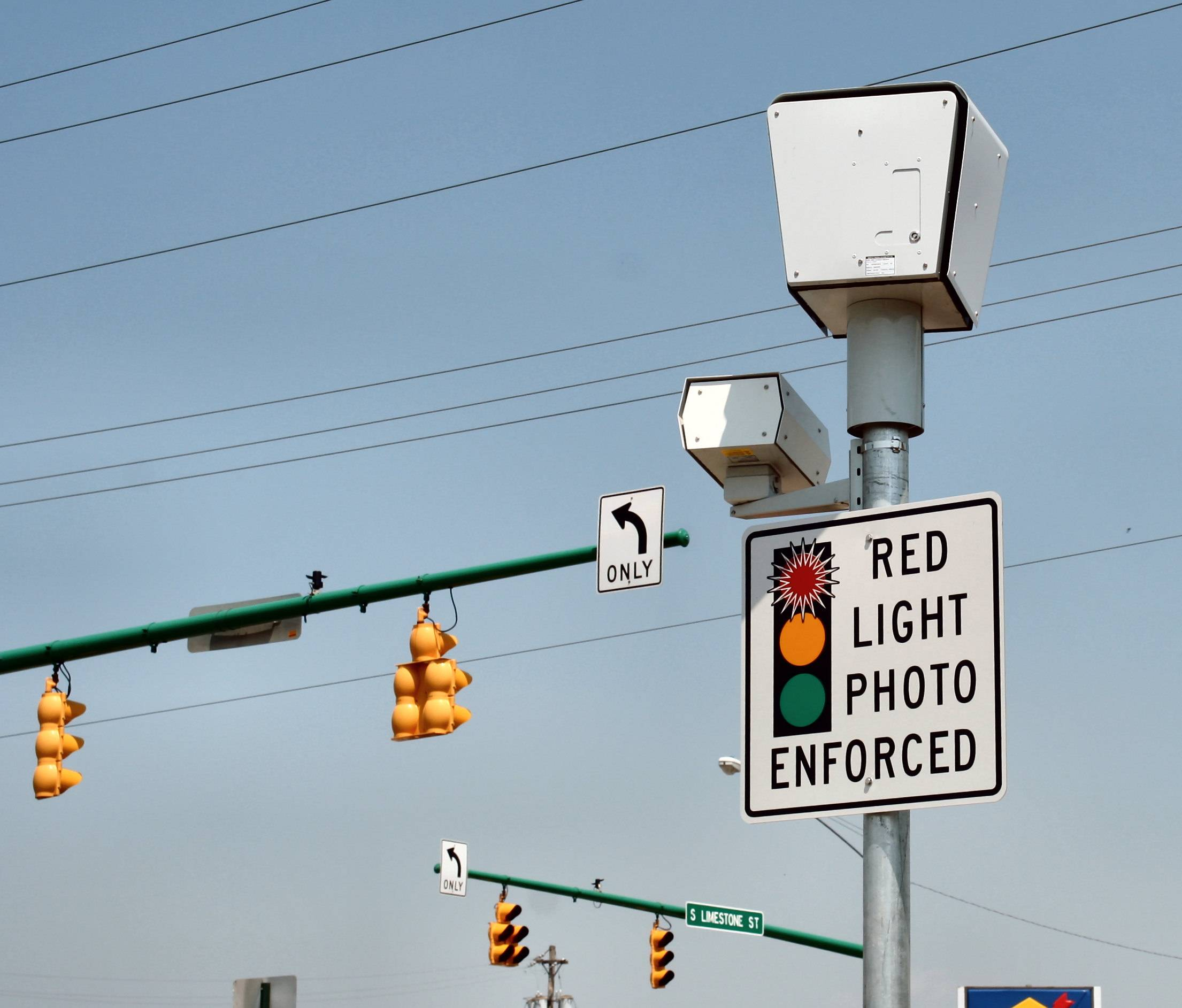 Red light cameras are commonly enforced at California ...